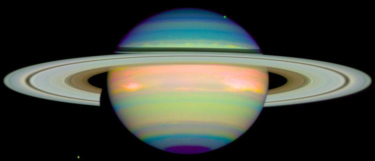 An infrared image of Saturn, the gas giant planet, taken using the Hubble space telescope for research done by the University of Arizona