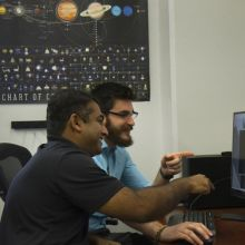Reddy and Campbell examine their animation of a Chinese space station flyby.