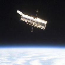 Hubble Space Telescope with earth in background