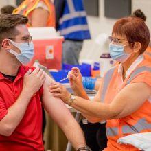 a man getting the COVID-19 vaccine