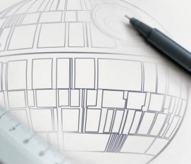 University of Arizona Cyber security image of Star Wars DeathStar architectural plans with a pen and ruler