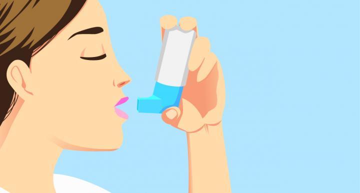 illustration of a woman using an asthma inhaler