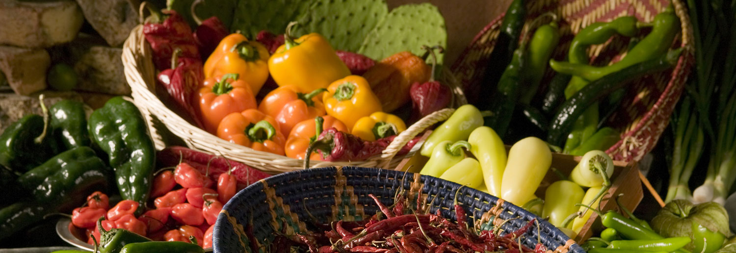 Baskets of peppers, chilis and cactus